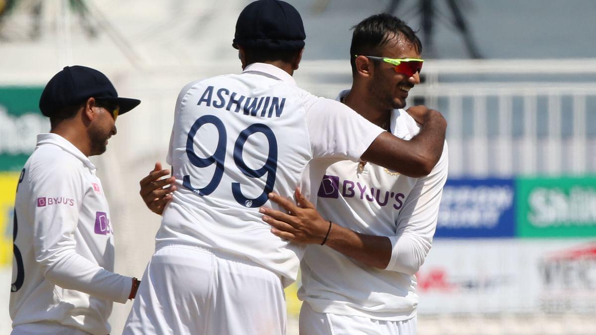 Axar Patel, R Ashwin and Kuldeep Yadav celebrate a wicket.