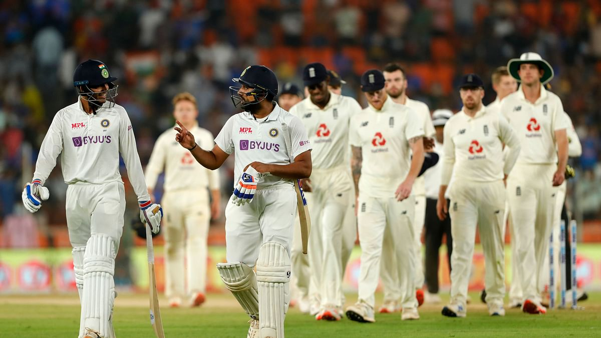 Rohit Sharma of India and Shubman Gill of India coming out after winning the match during day two of the third PayTM test match between India and England.
