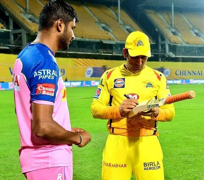 K Gowtham with MS Dhoni.