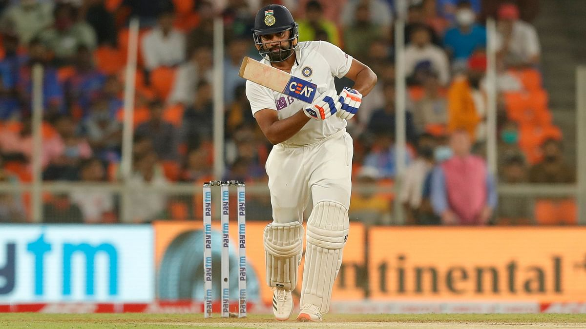 Rohit Sharma drives for a boundary during the first innings of the Pink Ball Test against England at Ahmedabad.