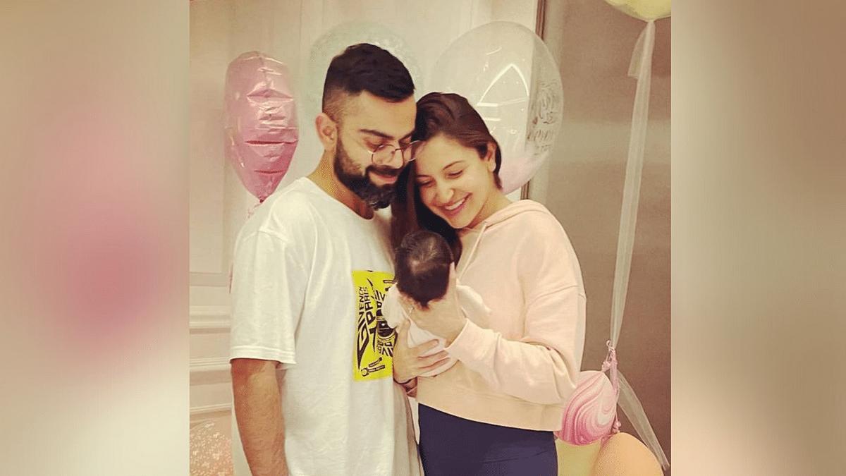 Virat Kohli and Anushka Sharma with their baby daughter.