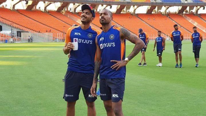 Hardik Pandya and Axar Patel share a light moment in training at Motera.
