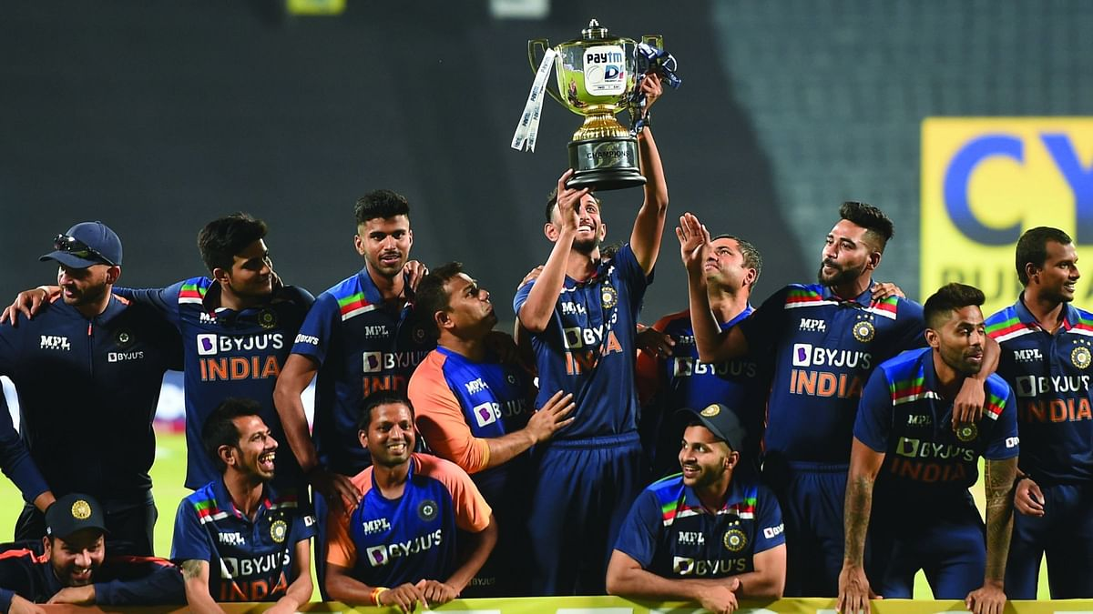Indian team poses with the trophy after winning the ODI series against England, at Maharashtra Cricket Association Stadium in Pune, Sunday, March 28, 2021.