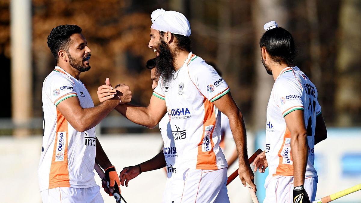 Jarmanpreet Singh celebrating with his teammates after scoring a goal