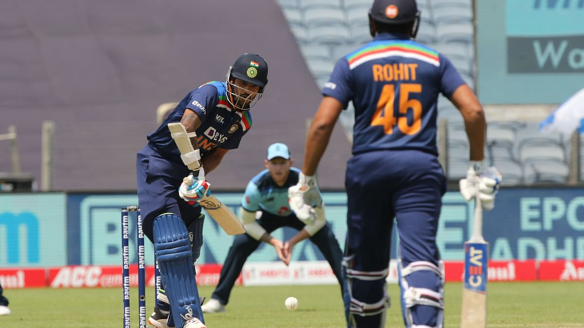 Shikhar Dhawan on the attack against England as Rohit Sharma looks on.
