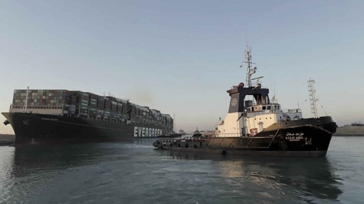In the photo released by Suez Canal Authority, the Ever Given, a Panama-flagged cargo ship is pulled by one of the Suez Canal tugboats, in the Suez Canal, Egypt on 29 March.