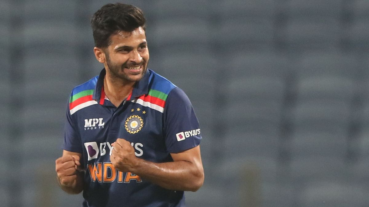 Shardul Thakur celebrates a wicket.