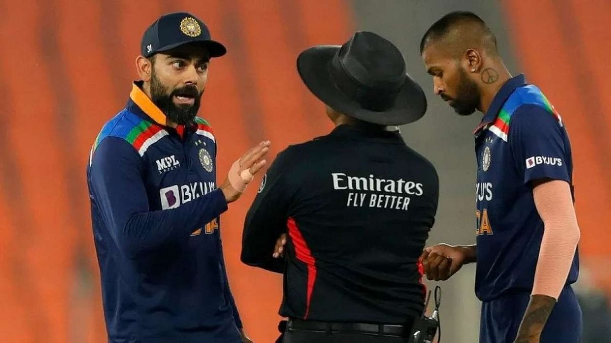 Virar Kohli speaking with the umpire during the T20I series against England.