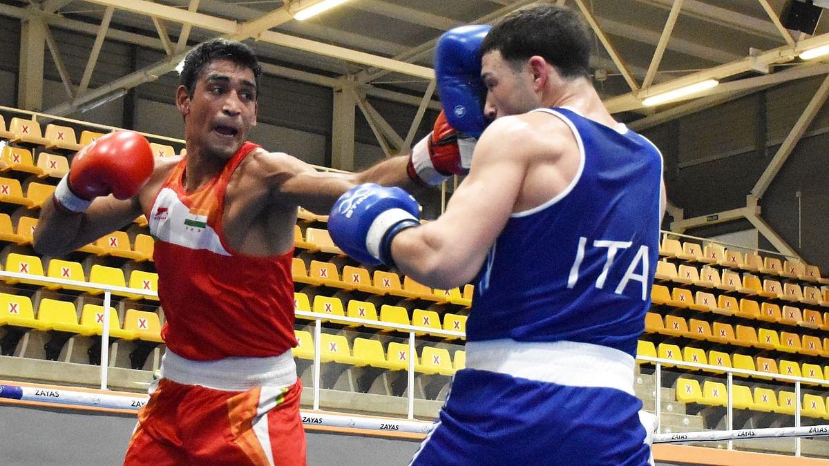 Ashish kumar (red) defeated Remo Salvatti of Itali 4-1 to reach the semis at the Boxam International Tournament in Castellon, Spain.