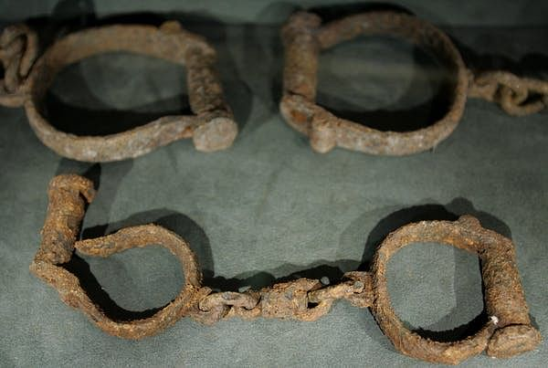 Sets of shackles used in the transportation of slaves, on display at the International Slavery Museum in Liverpool, England.