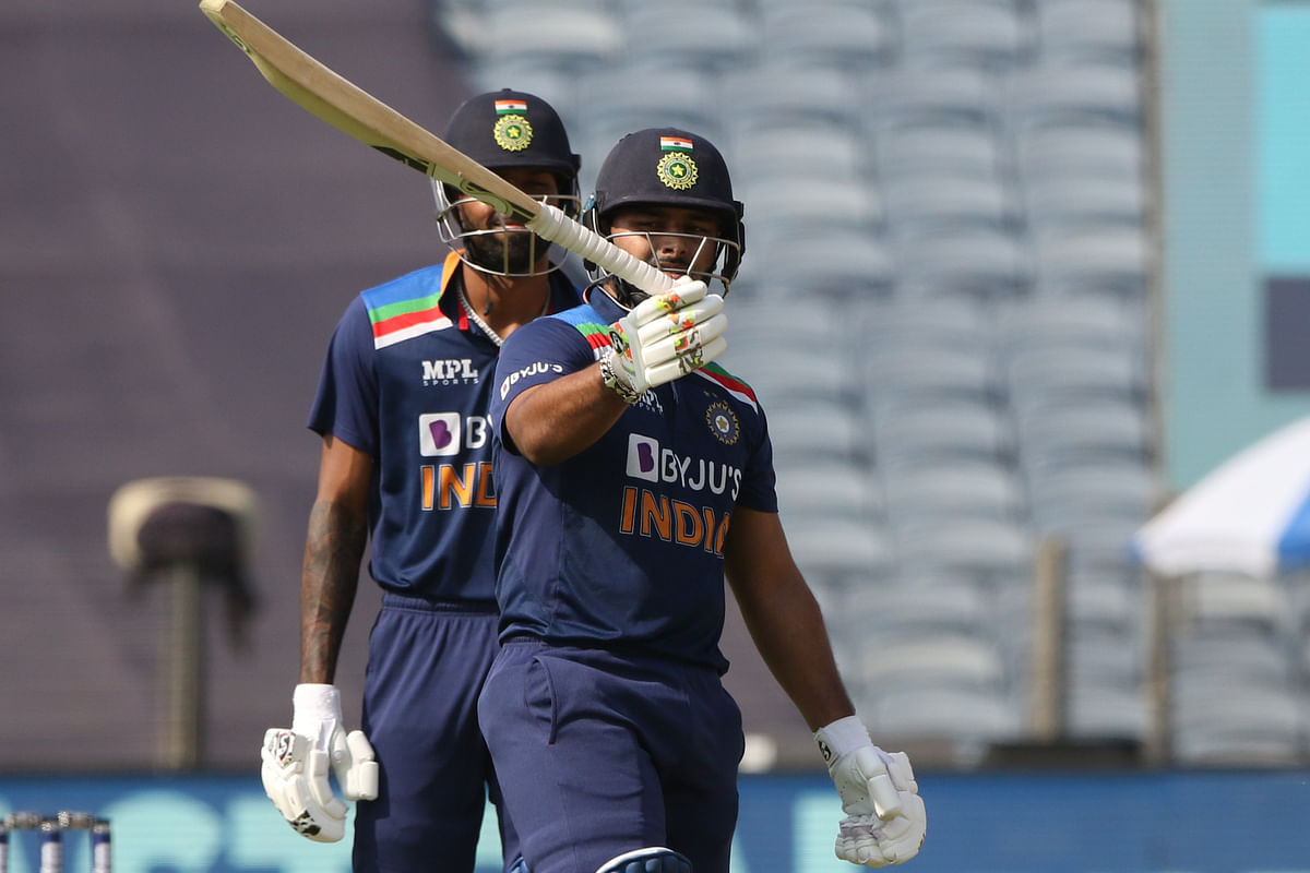 Rishabh Pant of (WK) India celebrates his fifty during the 3rd One Day International match between India and England held at the Maharashtra Cricket Association Stadium, Pune, India on the 28th March 2021