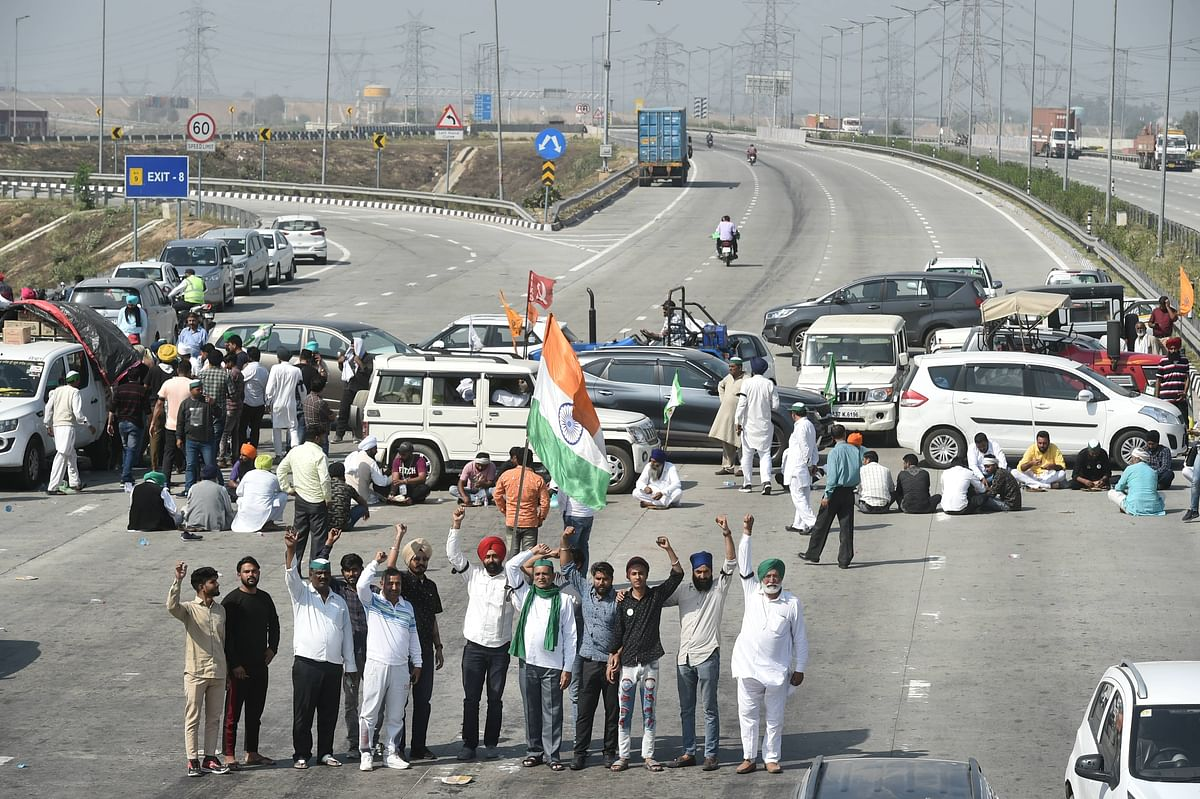 Farmers block the KMP Expressway near Duhai to mark the 100th day of their ongoing agitation against Centres farm reform laws, in Ghaziabad.