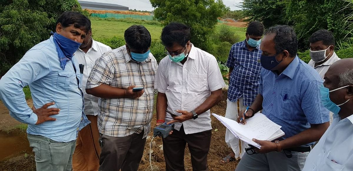 Raj along with activists and officials try to ascertain the contamination levels of the groundwater.