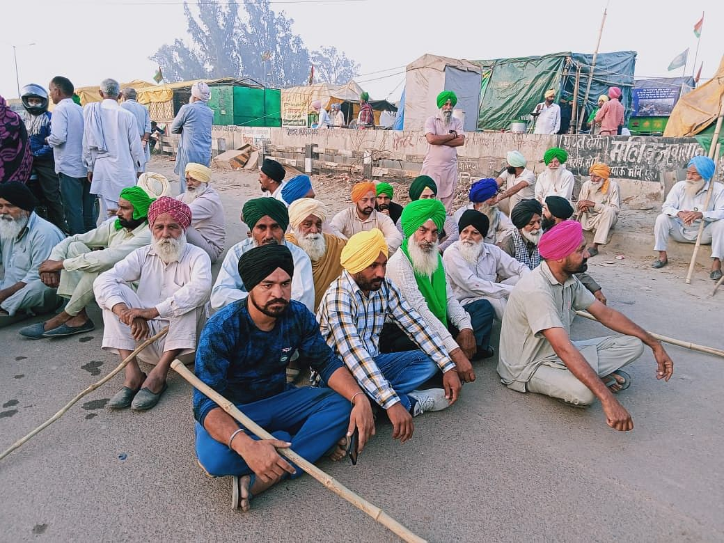 Near Sudhir Hotel, on the road for Delhi from Sonipat and adjoining parts, farmers participate in the nationwide strike on Friday.