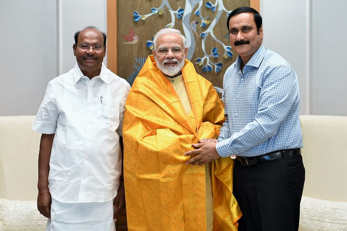 PMK founder Ramadoss and his son Anbumani Ramadoss with PM Modi.