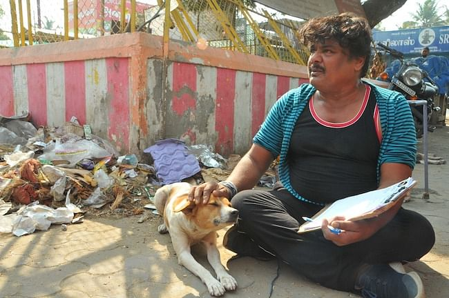 A street dog keeps Mansoor Ali Khan company during his campaign.