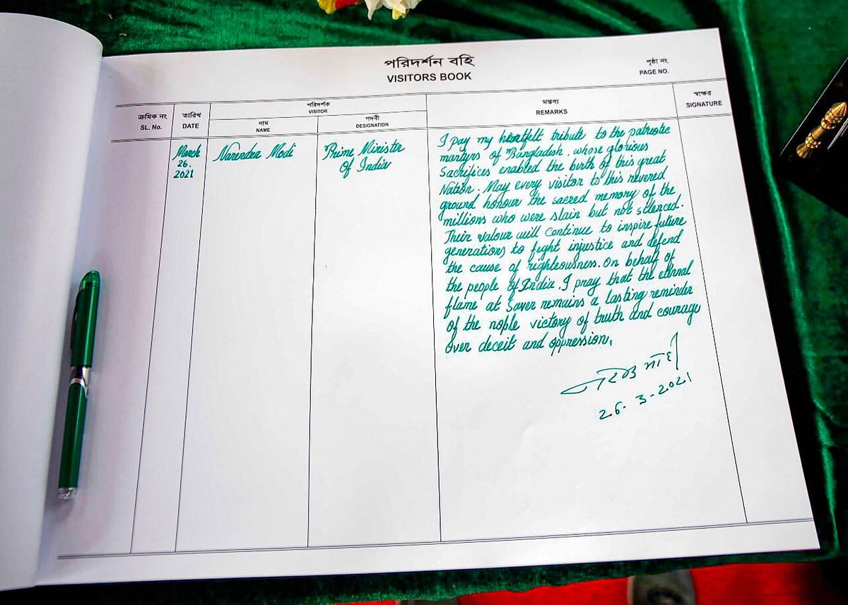 Prime Minister Narendra Modi's comments on the visitors' book at the National Martyr's Memorial in Savar, on the occasion of 50th Independence Day of Bangladesh, in Dhaka, Friday, March 26, 2021