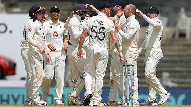 Jack Leach and England celebrate the fall of a wicket against India.