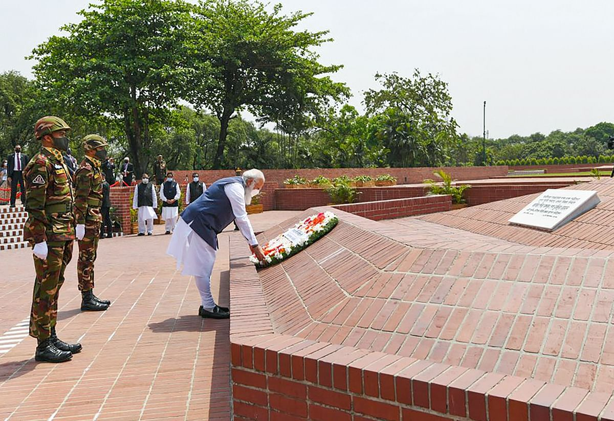 Prime Minister Narendra Modi pays tribute at at the National Martyr�s Memorial in Savar, on the occasion of 50th Independence Day of Bangladesh, in Dhaka, Friiday, March 26, 2021
