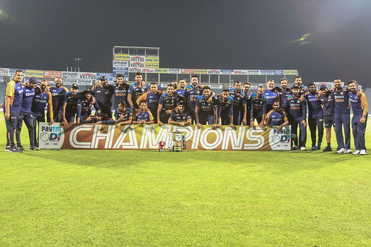 The Indian team stand with the winners' trophy after the 3rd ODI against England played at the Maharashtra Cricket Association Stadium, Pune, India on the 28th March 2021