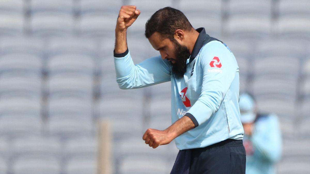 Adil Rashid celebrates the wicket of Virat Kohli.