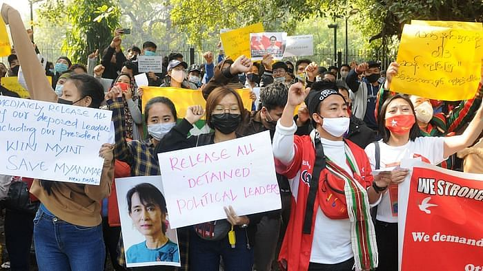 Myanmarese refugees in India participate in a protest against the ousting of Myanmar's elected government and its leader Aung San Suu Kyi, in New Delhi, Friday, 5 Feb 2021.