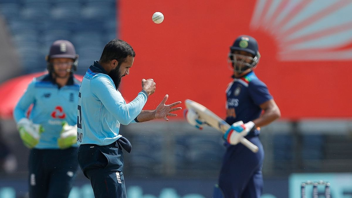 Adil Rashid of England celebrates the wicket of Shikhar Dhawan of India during the 3rd One Day International match between India and England held at the Maharashtra Cricket Association Stadium, Pune, India on the 28th March 2021