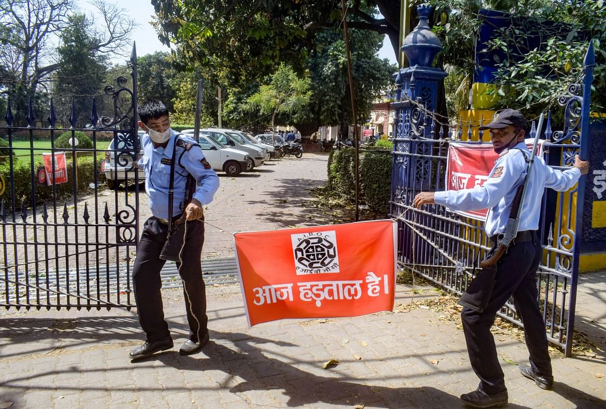 Security guards stand outside a closed Allahabad Bank during a nationwide strike, called by United Forum of Bank Unions (UFBU), to protest against the proposed privatisation of two state-owned lenders, in Prayagraj.