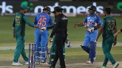 India and Pakistan players shake hands after the game in Delhi.