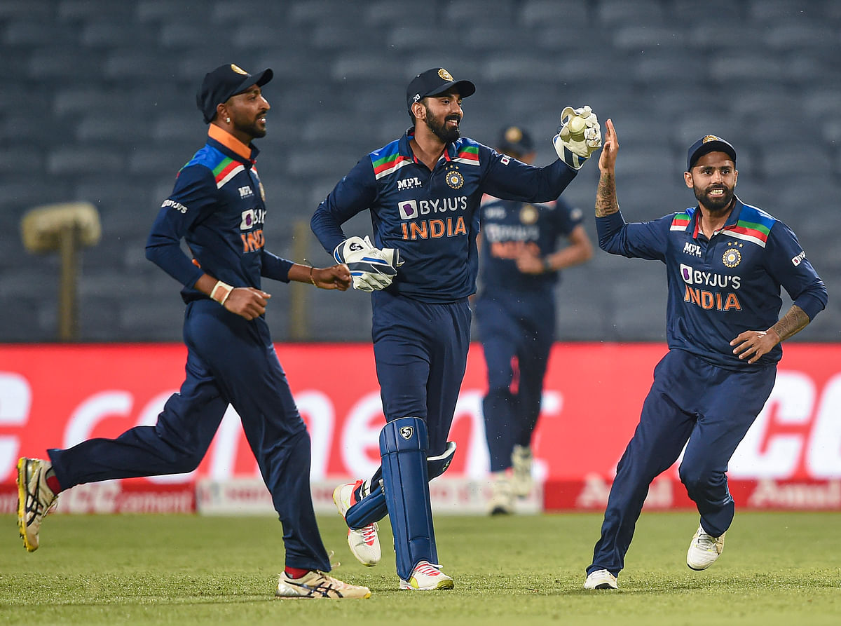 Pune: Indian cricketer Krunal Pandya, KL Rahul and Suryakumar Yadav celebrates the wicket of England cricketer Moeen Ali during the first One Day International cricket match between India and England.