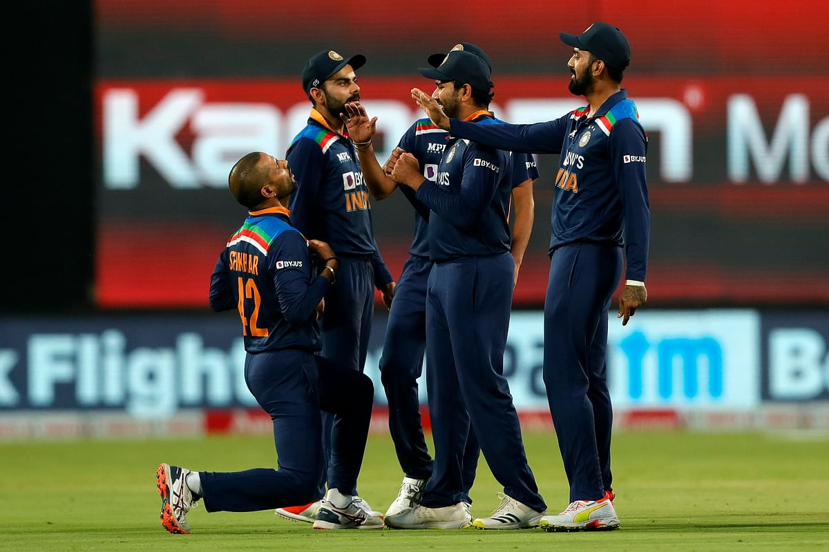 The Indian team celebrate the wicket of Ben Stokes of England during the 3rd One Day International match between India and England held at the Maharashtra Cricket Association Stadium, Pune, India on the 28th March 2021