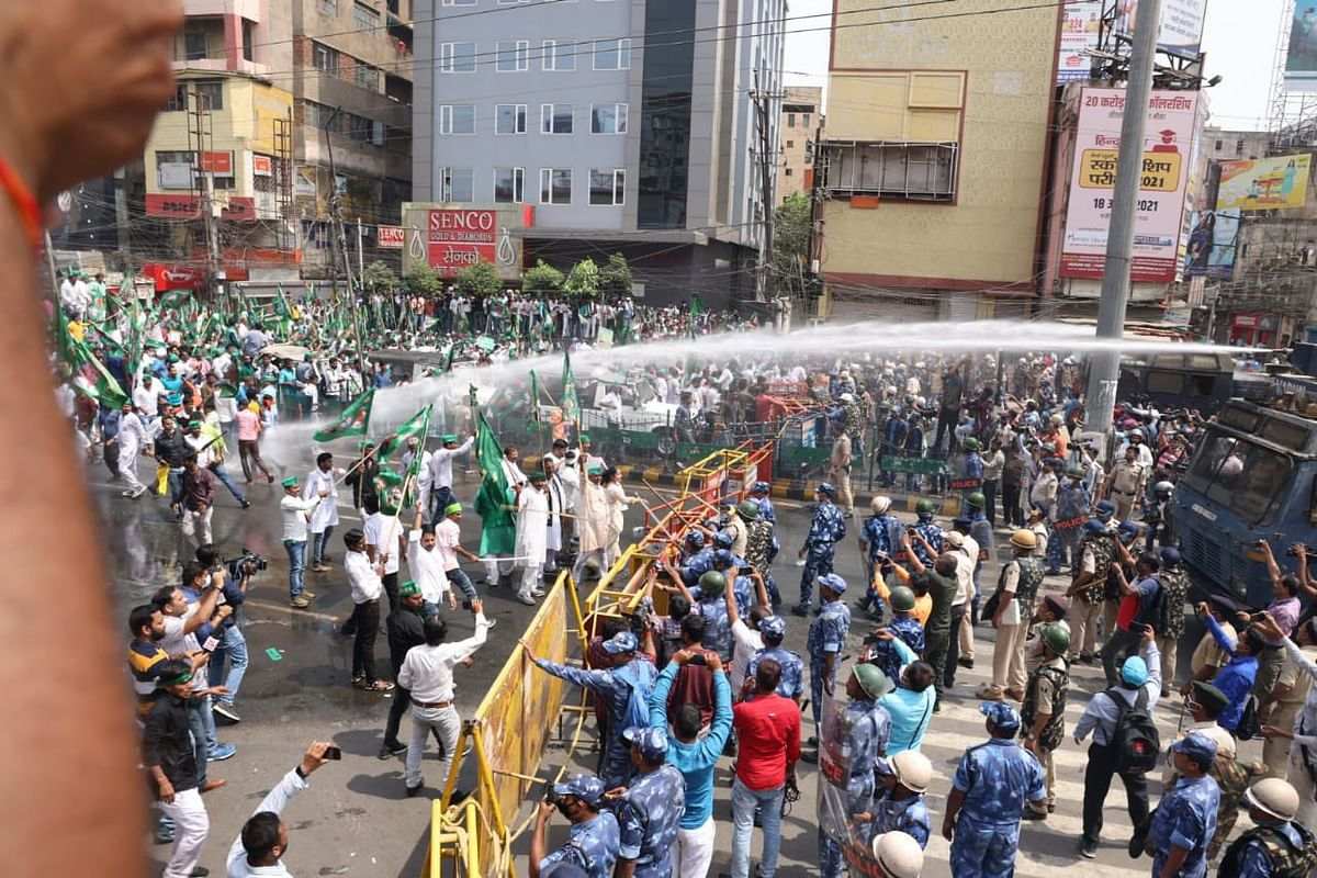Stones were reportedly pelted by RJD workers outside the Bihar Assembly, and the police unleashed water canons on them.