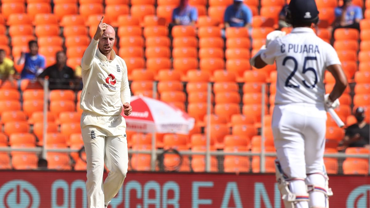 Jack Leach celebrates the wicket of Cheteshwar Pujara on Day 2 in the fourth Test.