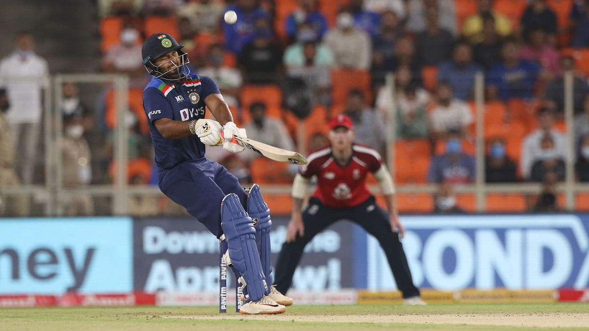 Rishabh Pant reverse scoops Jofra Archer for 6 during the first T20I.