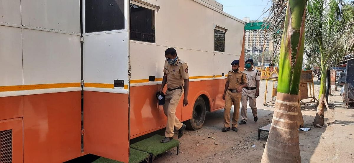 "<div class=""paragraphs""><p>Policemen outside Ketan Rawal's van</p></div>"