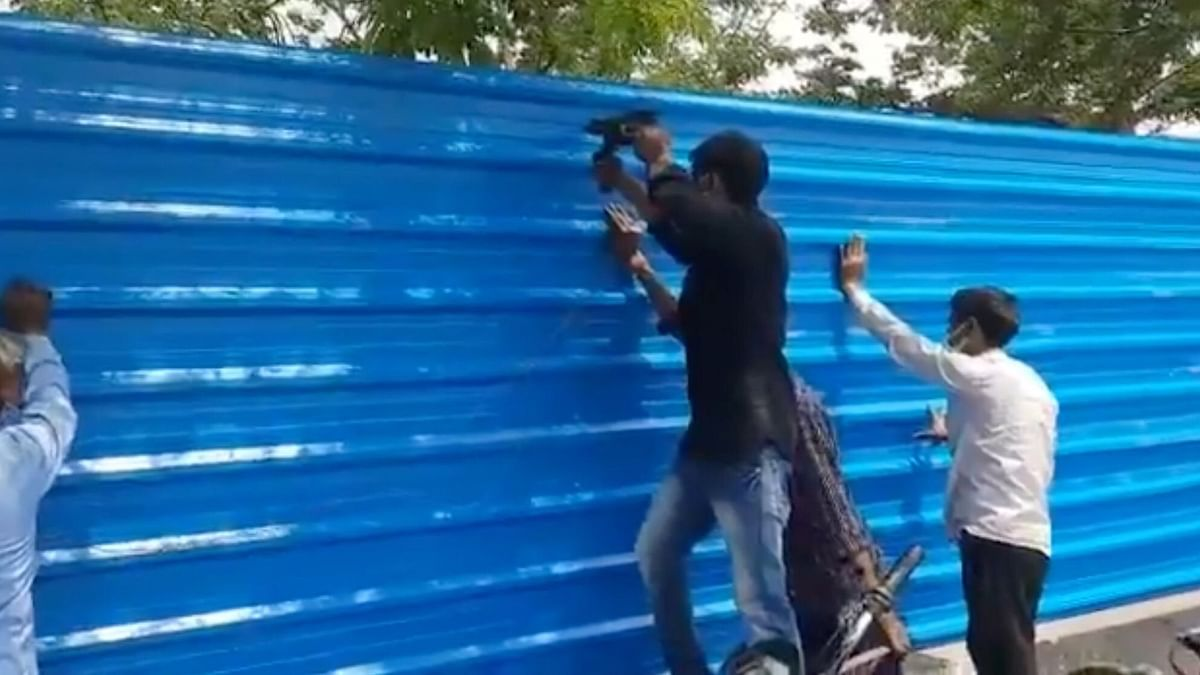 Blue tin sheets were used to to cover the view of Lucknow's Bhainsakund cremation site on Thursday, 15 April.