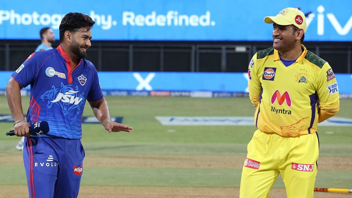 Rishabh Pant and MS Dhoni share a light moment before the toss.