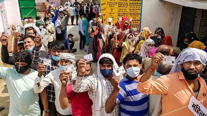 Agra voters stand in snugly-packed queues as the second wave of the pandemic surges.