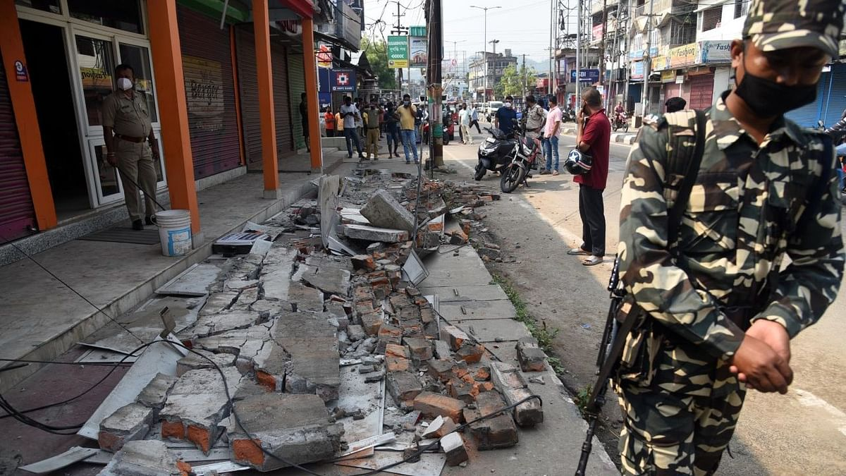Security personnel stand guard near a building in Guwahati, Assam, that was damaged in an earthquake of a magnitude of 6.4 on the Richter Scale at 7:51 am on Wednesday, 28 April. The epicentre of the quake was 43 km west of Tezpur.