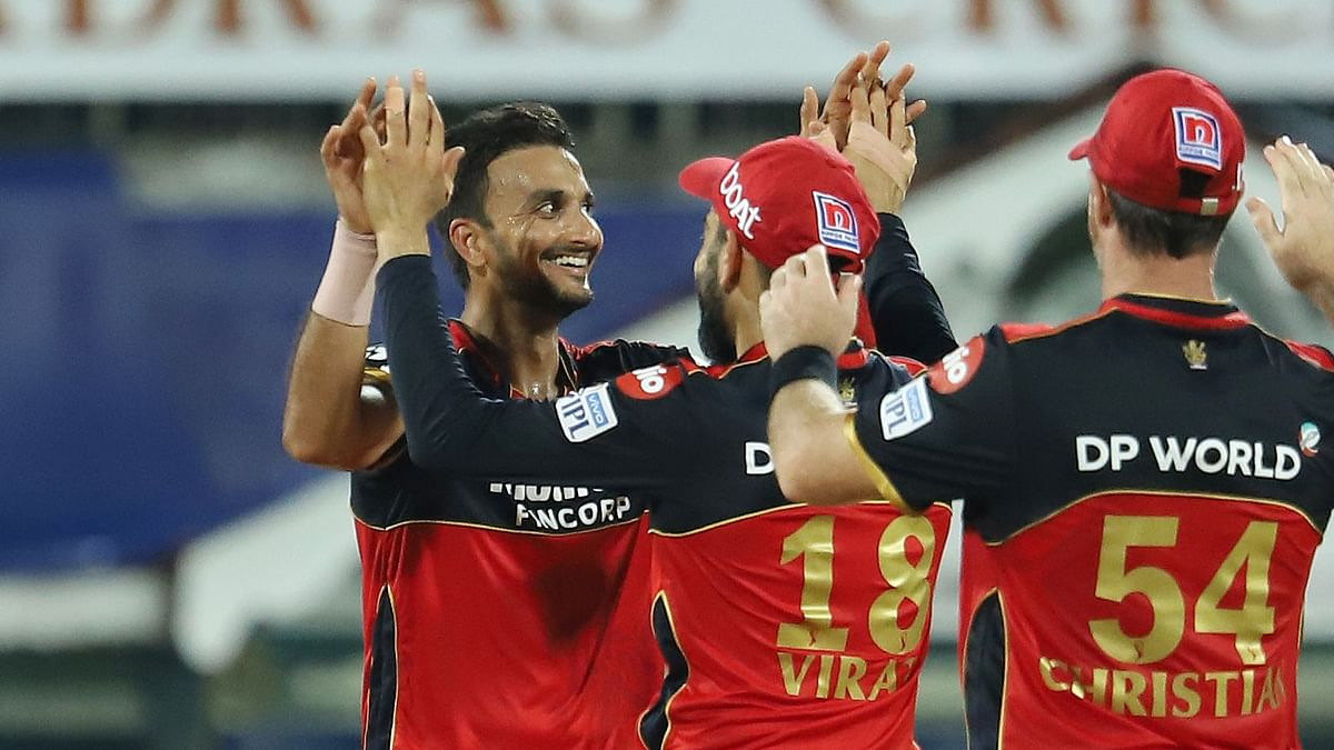 Harshal Patel celebrates one of his five wickets in the 2021 IPL season-opener against Mumbai Indians.