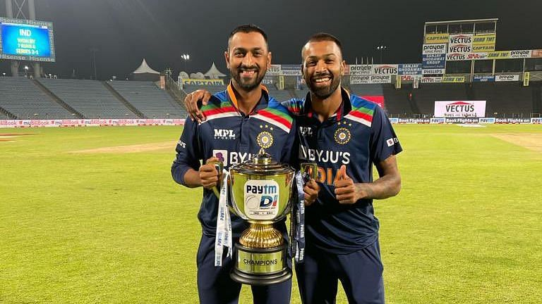 Hardik and Krunal Pandya pose with the trophy after winning the ODI series against England.