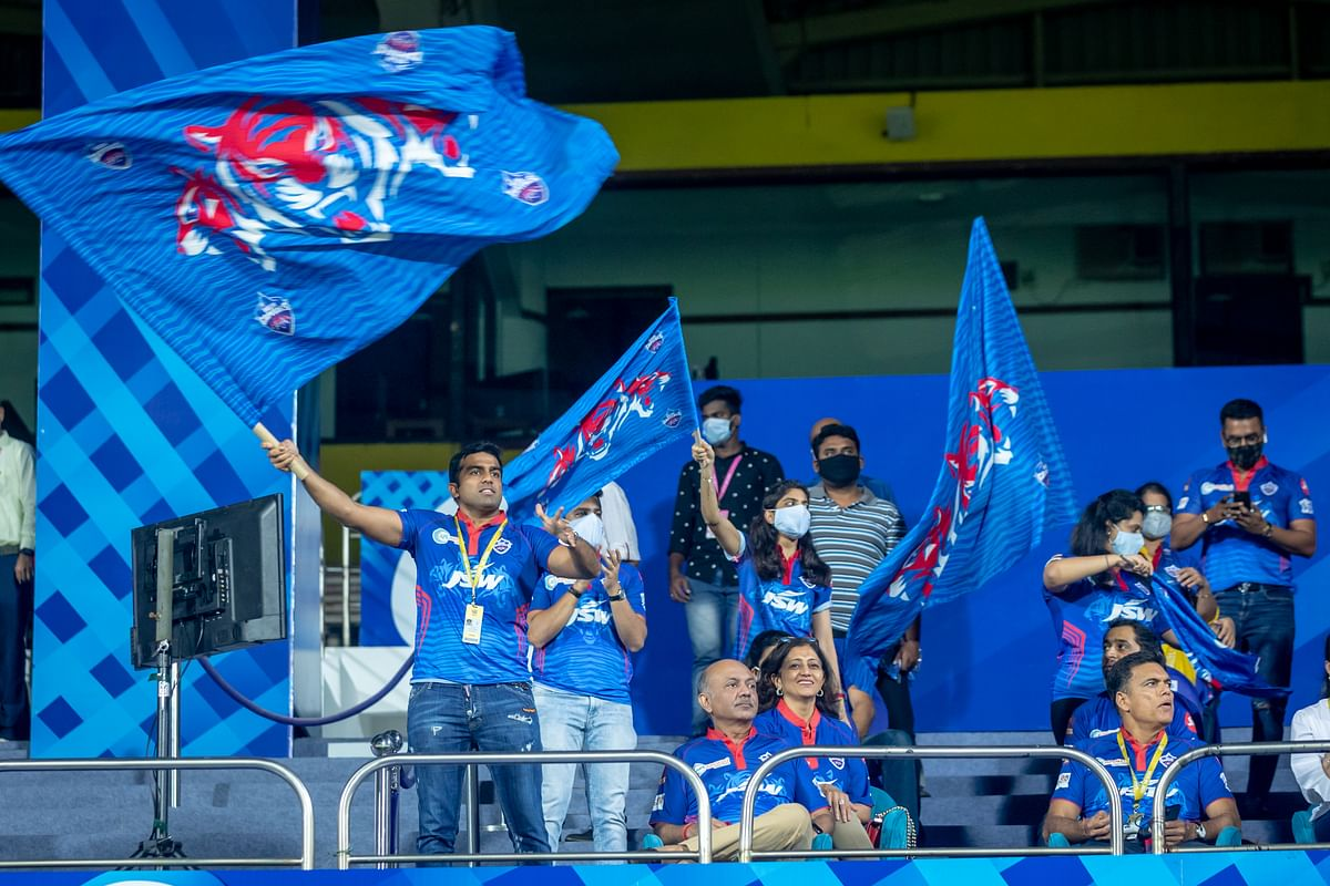 Delhi Capitals team owners in the stands during an IPL 2021 game setting no examples on masking during the pandemic.
