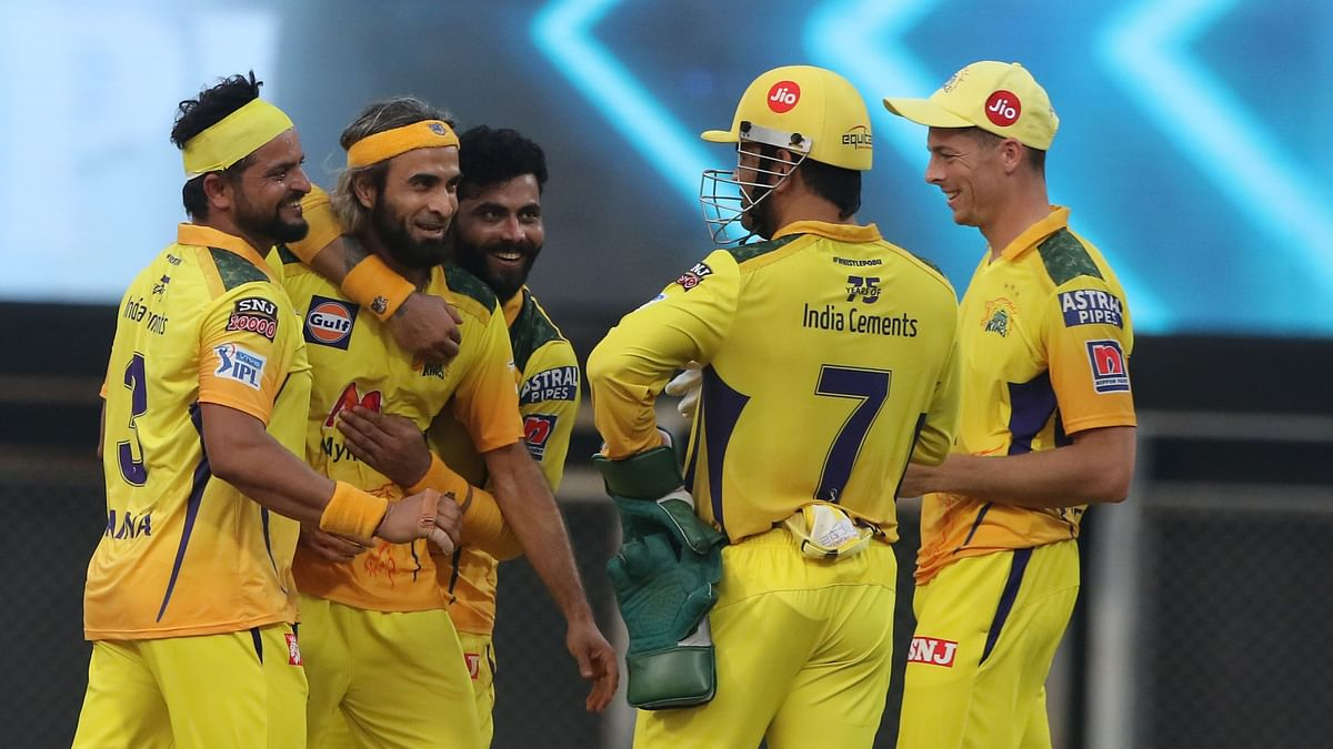 CSK players celebrate an RCB wicket during the team's victory on Sunday.