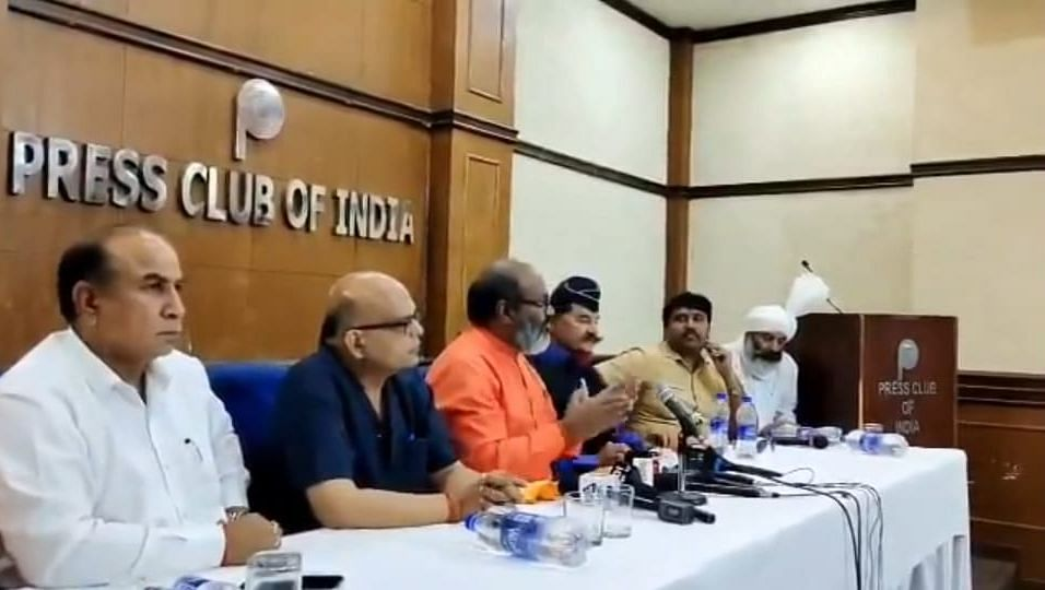 In orange is Narsinghananad, speaking at Delhi's Press Club of India.
