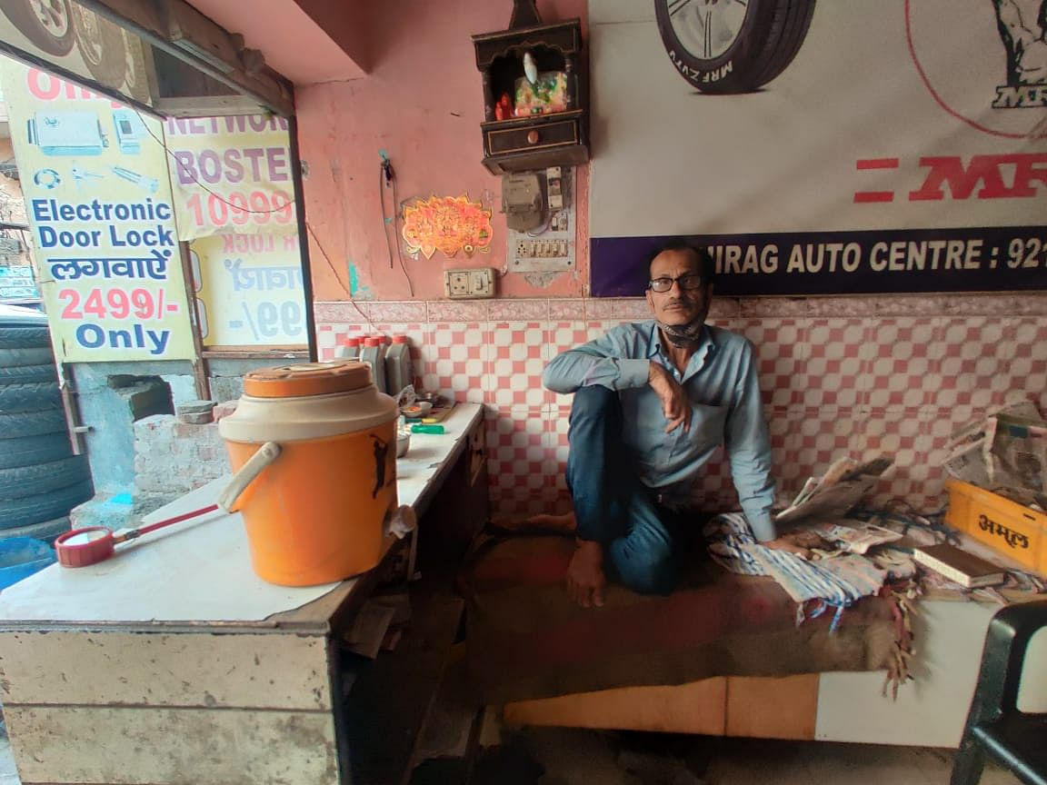 Gulshan Kumar pays Rs 6,000 rent for his one-room tyre shop in Budh Vihar.