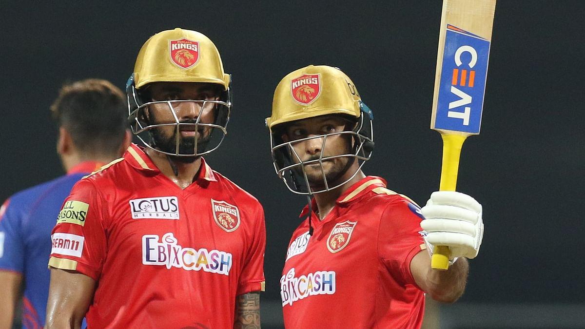 Mayank Agarwal raises his bat to celebrate his first half century of IPL 2021.