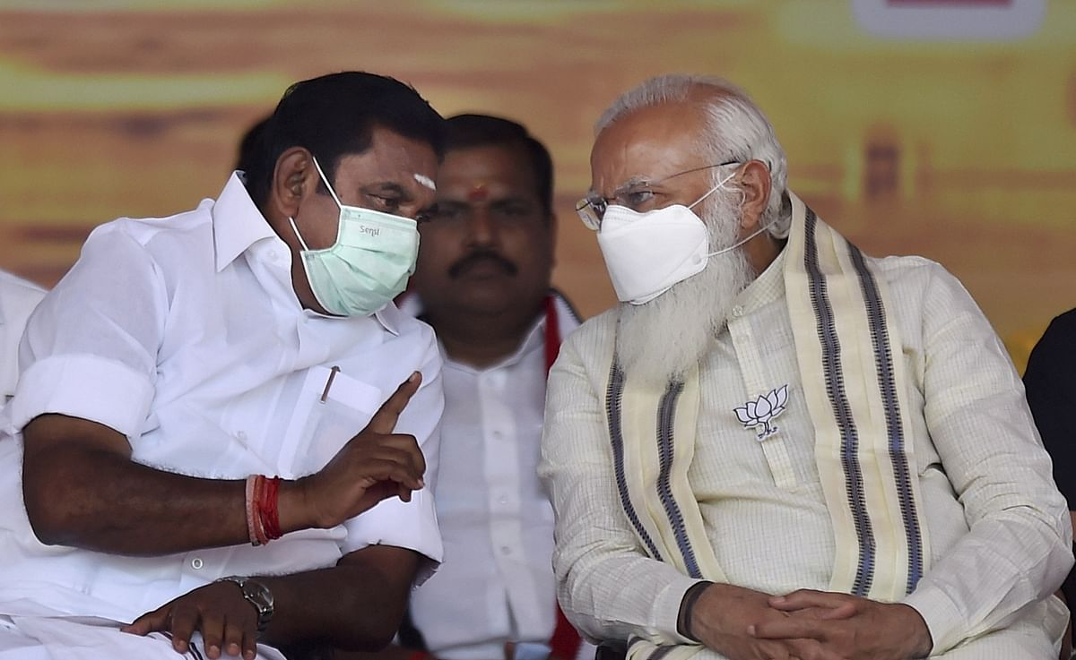 Prime Minister Narendra Modi along with Tamil Nadu Chief Minister K Palaniswami during a public meeting as part of election campaign in support of their NDA alliance party candidates ahead of Tamil Nadu assembly polls, in Madurai, Friday, April 2, 2021