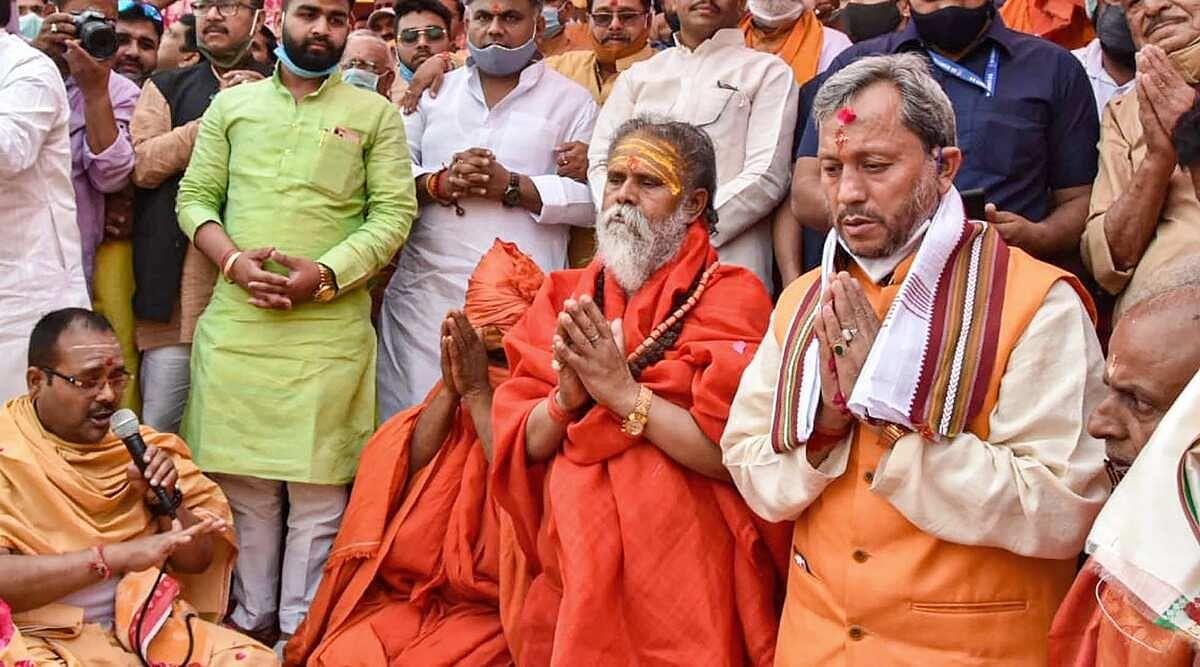 Tirath Singh Rawat at Kumbh Mela without a mask
