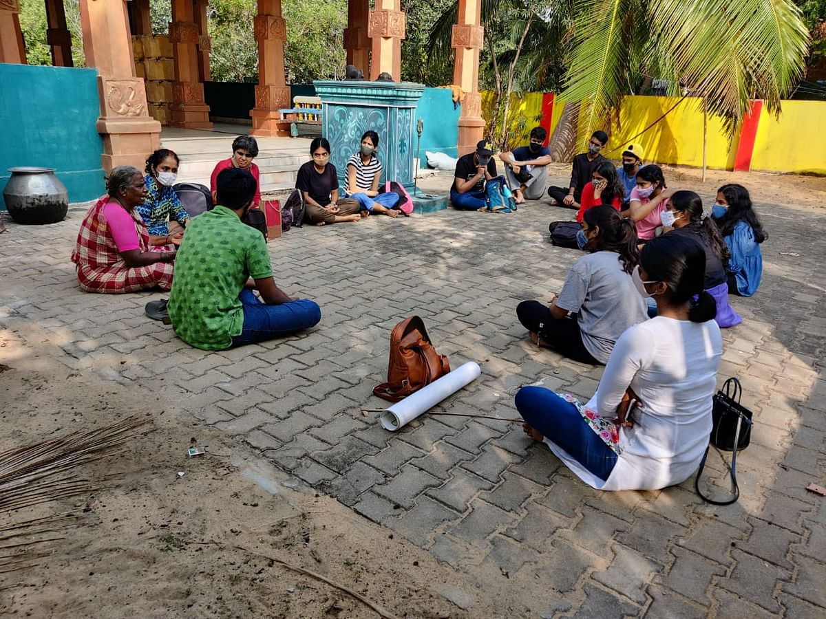 Students listening to fisherwomen at Kattupalli on how they have been  displaced several times and the impact the proposed Adani port will have on their lives.
