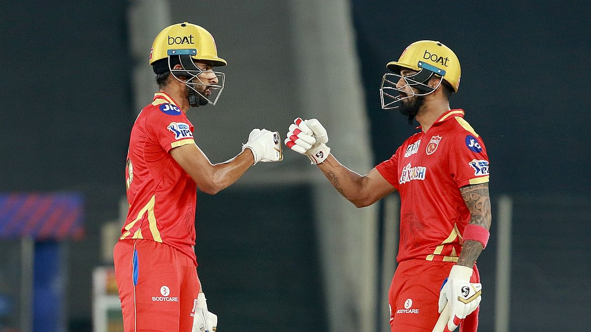KL Rahul, captain of Punjab Kings, and Harpreet Brar of Punjab Kings during match 26 of the Vivo Indian Premier League 2021 between the Punjab Kings and the Royal Challengers Bangalore.